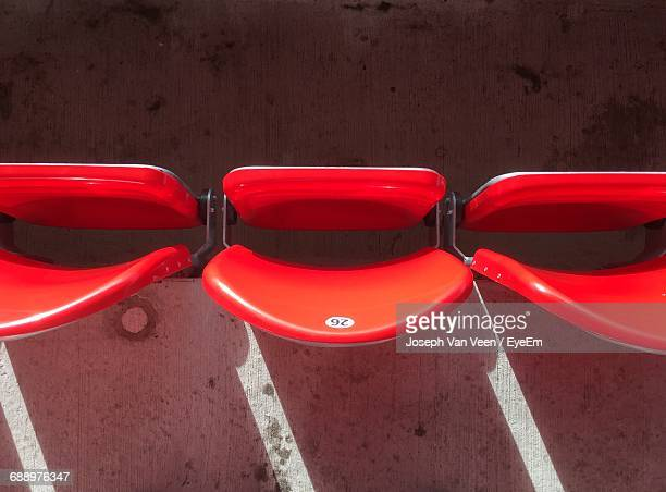 high angle view of folded seats at stadium - cadeira dobrável - fotografias e filmes do acervo