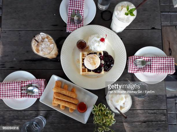 High Angle View Of Food And Drink On Table