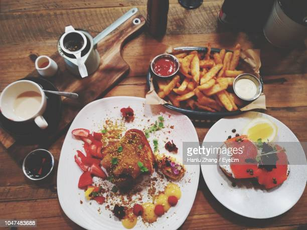 high angle view of food and drink served on table - camberwell stock photos and pictures