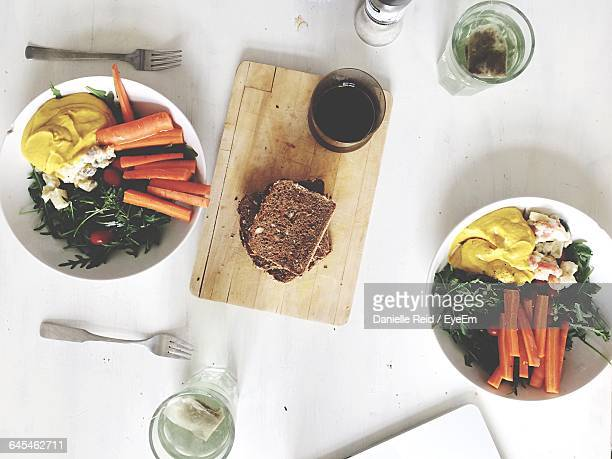 high angle view of food and drink served on table - danielle reid stock pictures, royalty-free photos & images