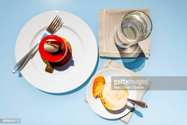 High Angle View Of Food And Drink Served On Table