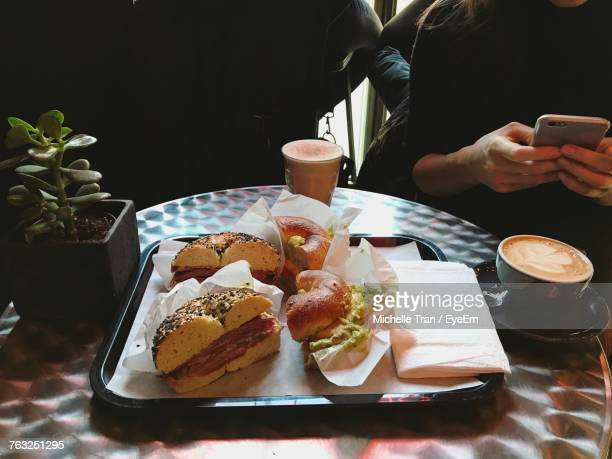 High Angle View Of Food And Drinks Served On Table