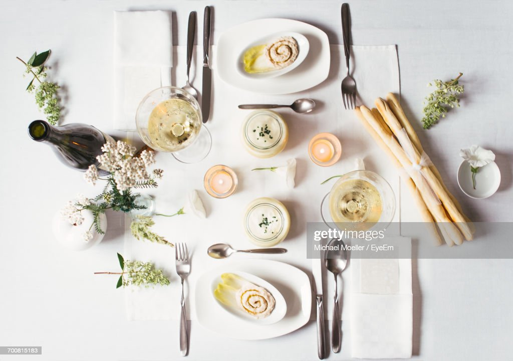 High Angle View Of Food And Place Setting : Stock Photo