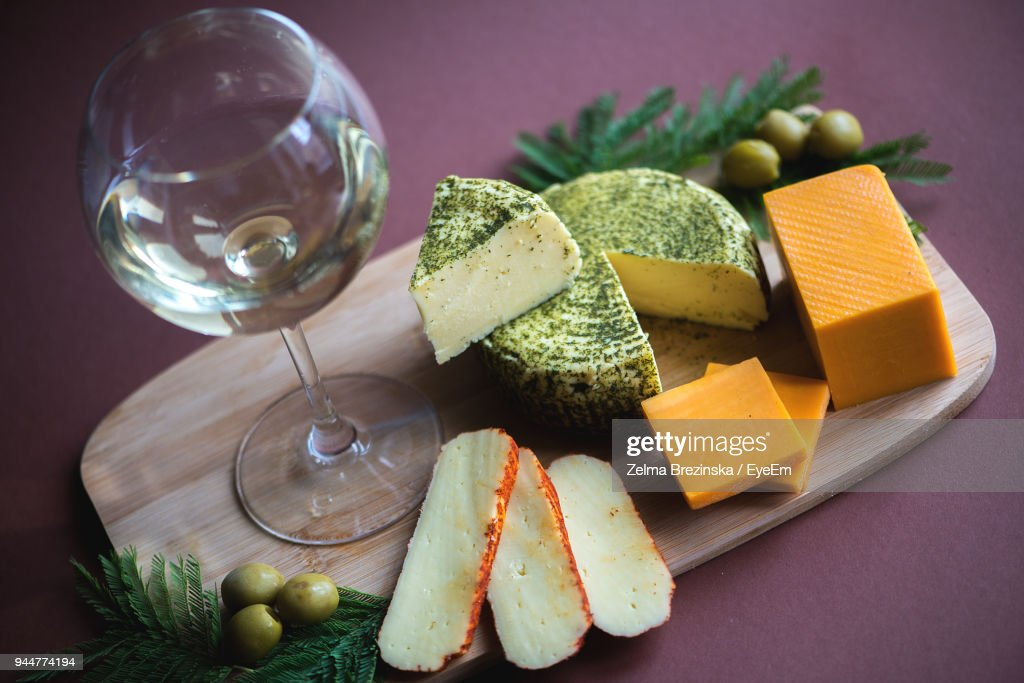 High Angle View Of Food And Wine On Cutting Board : Stock Photo