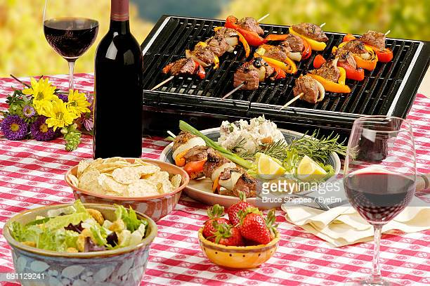 High Angle View Of Food And Wine On Table