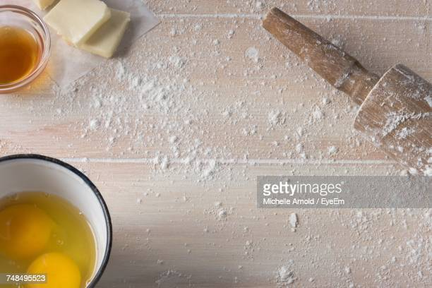 High Angle View Of Food By Rolling Pin On Wooden Table