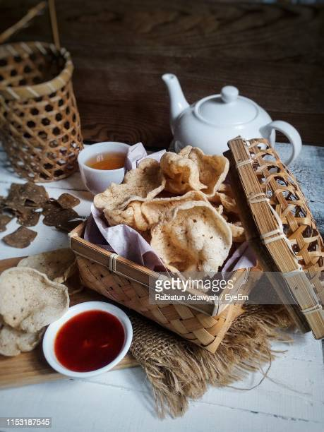 high angle view of food in basket on table - cracker snack stock photos and pictures