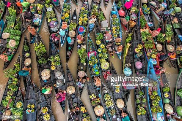 high angle view of food in boat over lake - indonesien stock-fotos und bilder