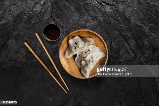 high angle view of food in bowl by sauce on slate - おかず系 ストックフォトと画像