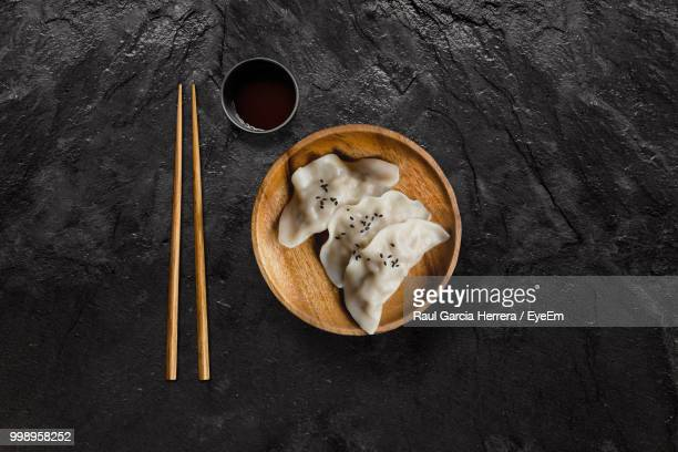 high angle view of food in bowl by sauce on slate - japanese food stock pictures, royalty-free photos & images