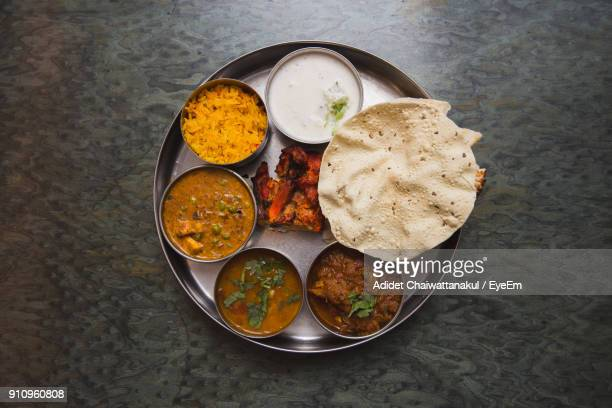 high angle view of food in plate on table - indian food stock photos and pictures