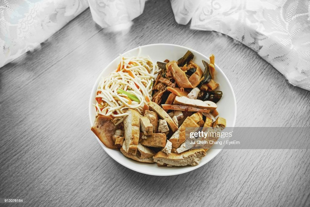 High Angle View Of Food In Plate On Table : Stock Photo