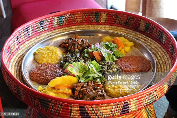 high angle view of food in plate - ethiopia stock photos and pictures