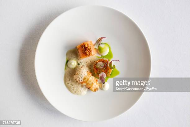 high angle view of food in plate - fine dining stock pictures, royalty-free photos & images