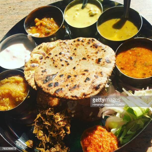 high angle view of food in plate - indian food stock pictures, royalty-free photos & images