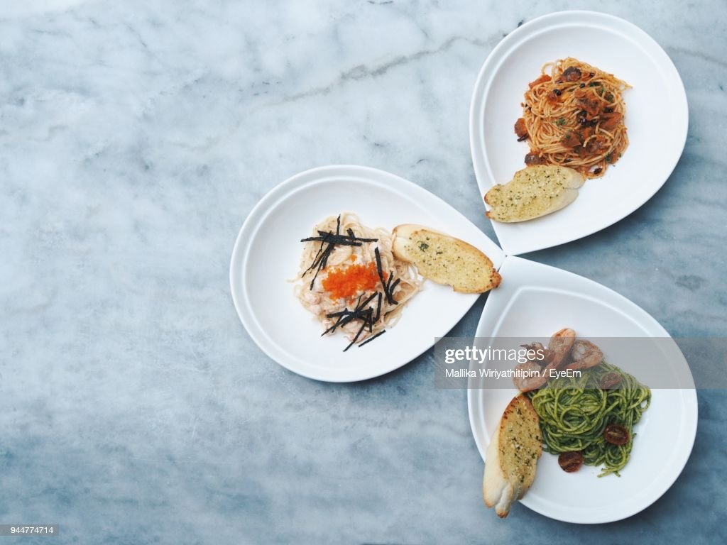 High Angle View Of Food In Plates On Marble : Stock Photo