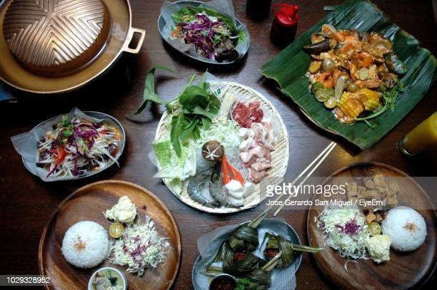 high angle view of food in plates on table - san stock pictures, royalty-free photos & images