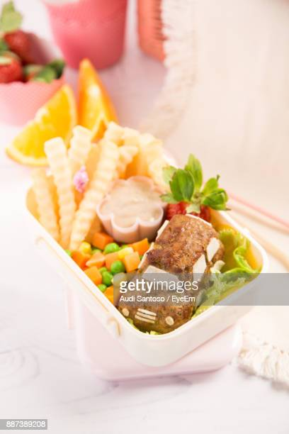 High Angle View Of Food In Tiffin Box On Table