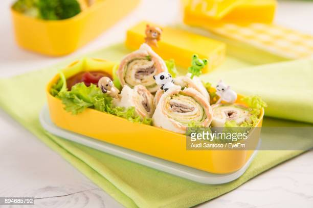 high angle view of food in tiffin box on table - tiffin box photos et images de collection
