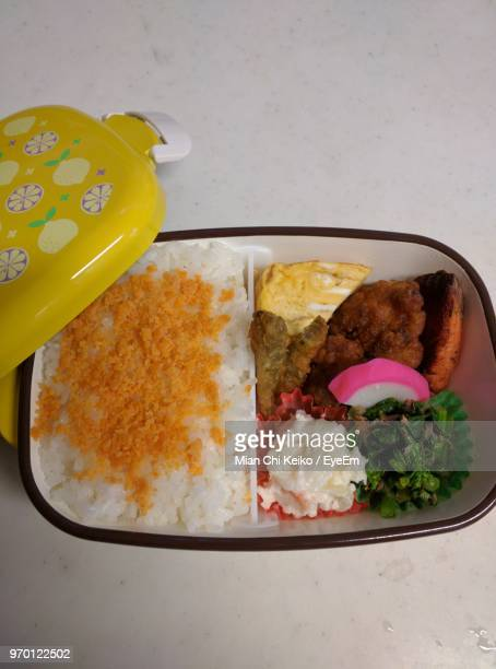 high angle view of food in tiffin on table - tiffin box photos et images de collection