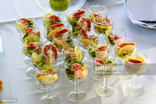 High Angle View Of Food In Wineglasses Arranged On Table