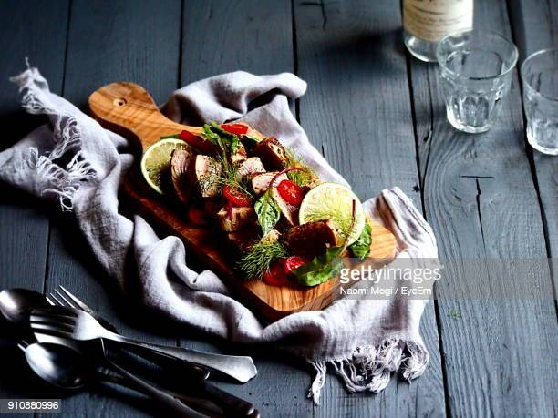High Angle View Of Food On Cutting Board Over Table