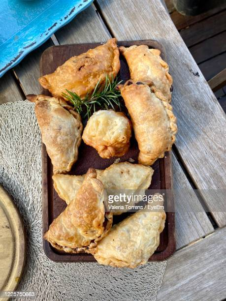 high angle view of food on table - empanada stock pictures, royalty-free photos & images