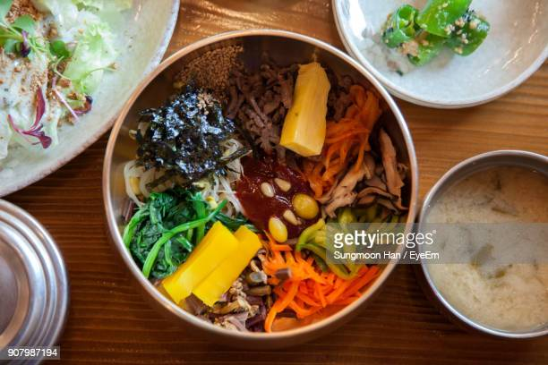 high angle view of food on table - jeonju stock photos and pictures