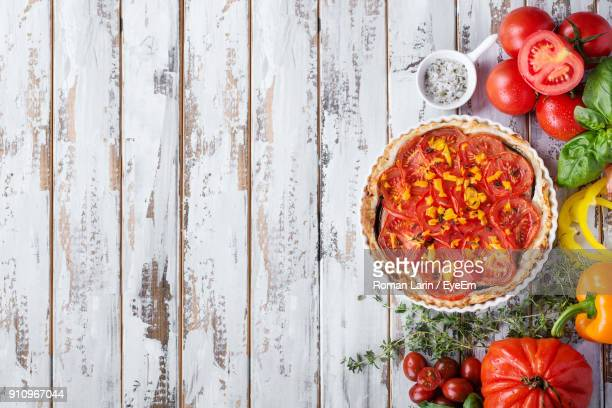 high angle view of food on table - savory pie stock photos and pictures