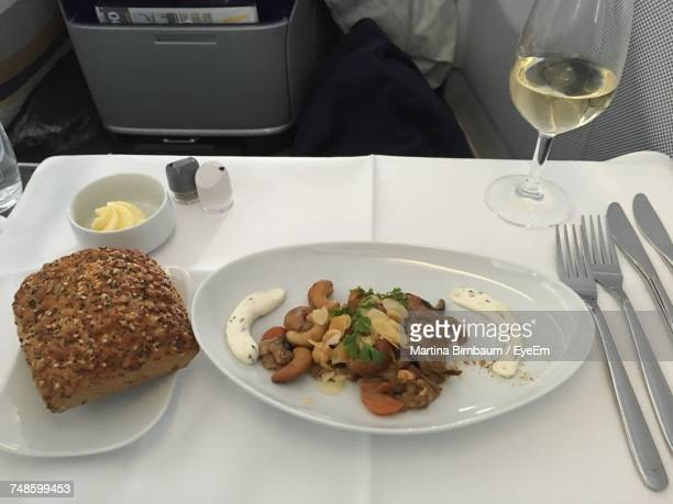 High Angle View Of Food Served In Plate On Table At Airplane