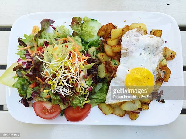 high angle view of food served in plate on table - tarrytown stock photos and pictures