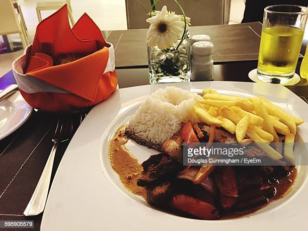 High Angle View Of Food Served In Plate On Table