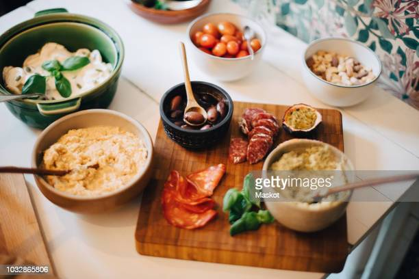 high angle view of food served on dining table in party at home - organic compound stock photos and pictures