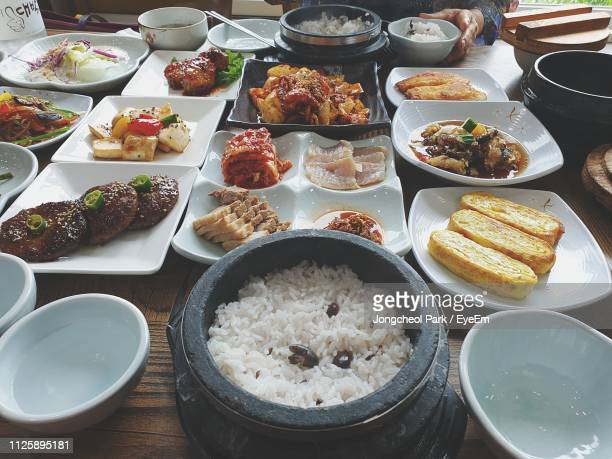 high angle view of food served on table - 韓国料理 ストックフォトと画像