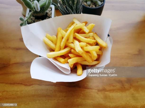 high angle view of food served on table - fast food french fries stock pictures, royalty-free photos & images
