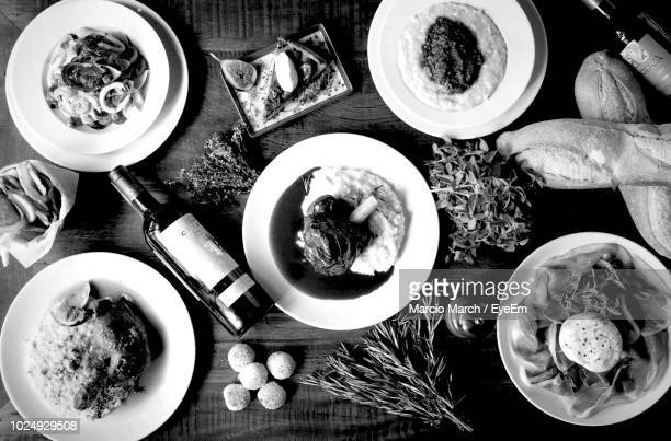 high angle view of food served on wooden table - black and white food stock pictures, royalty-free photos & images