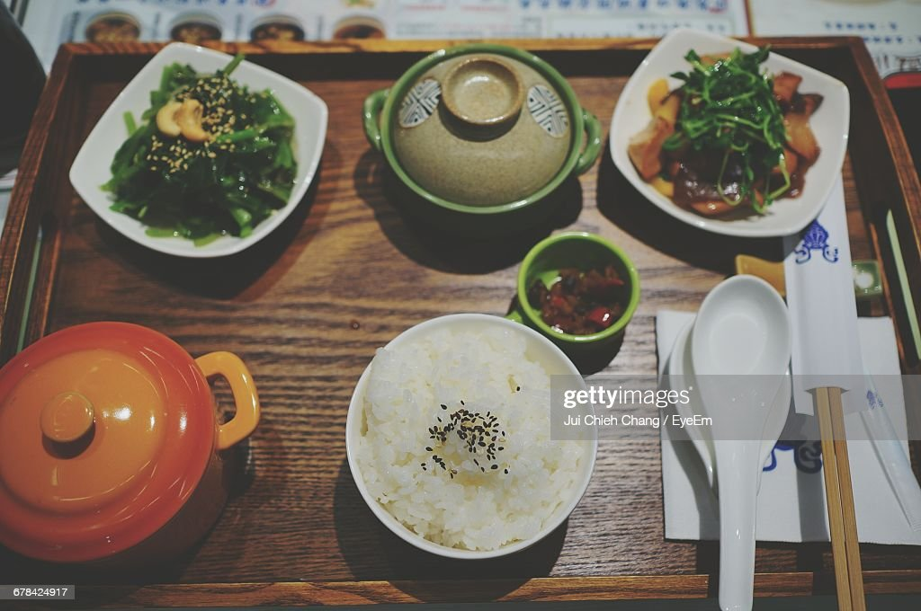 High Angle View Of Food Served On Wooden Tray : Foto de stock