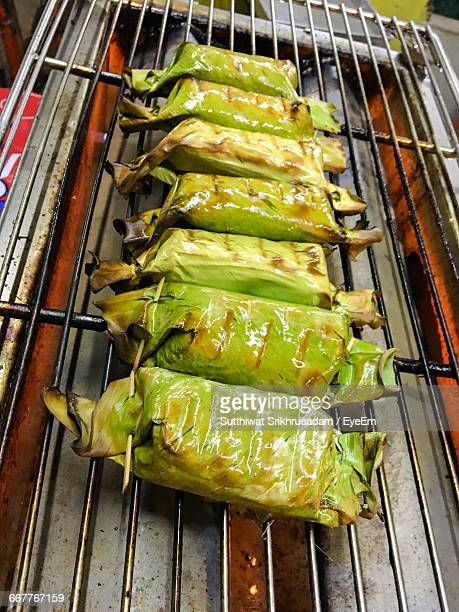 High Angle View Of Food Wrapped In Leaf On Grill At Market Stall