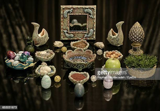high angle view of foods and decorations on table at nowruz - persian new year stock photos and pictures