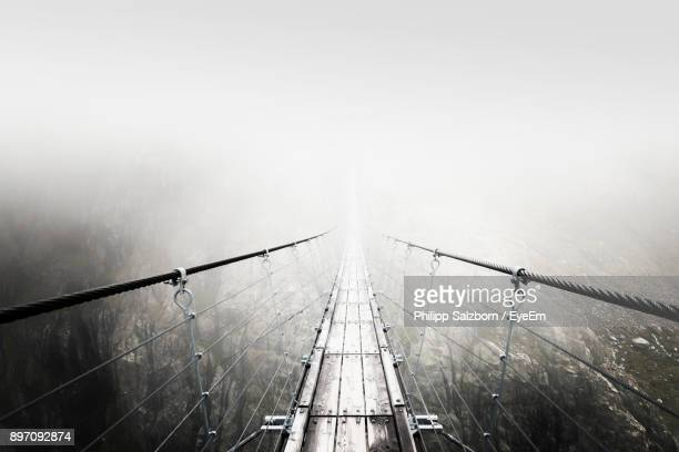 High Angle View Of Footbridge In Foggy Weather