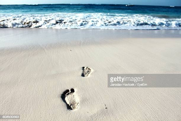 High Angle View Of Footprint On Sand At Beach
