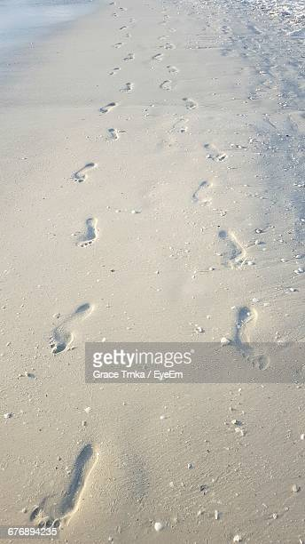 high angle view of footprints on beach - marco island stock pictures, royalty-free photos & images