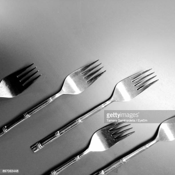 High Angle View Of Forks On Gray Background