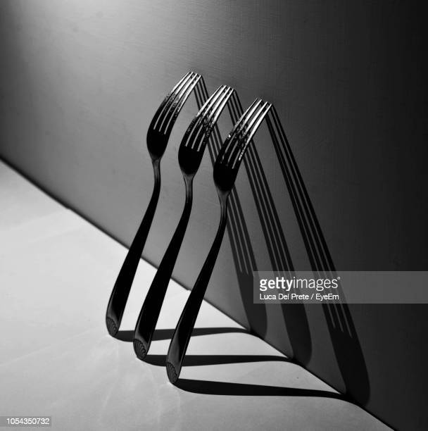 high angle view of forks on table - silverware stock pictures, royalty-free photos & images
