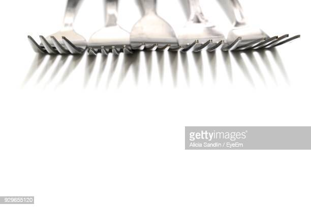 High Angle View Of Forks On White Background