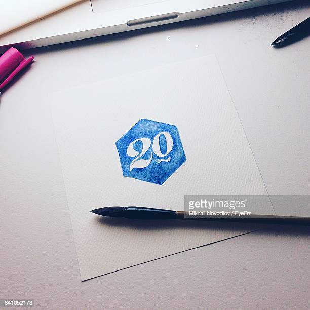 high angle view of fountain pen by number 20 written on paper - number 20 stock pictures, royalty-free photos & images