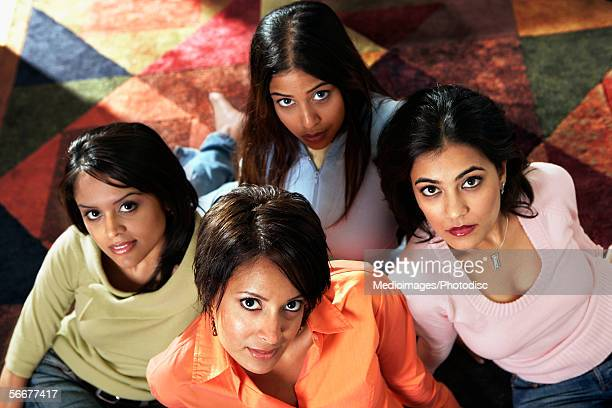 high angle view of four young women sitting on a rug - indian cleavage stock pictures, royalty-free photos & images
