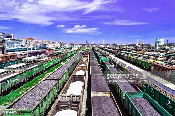 High Angle View Of Freight Trains At Shunting Yard Against Sky
