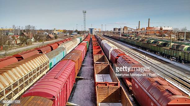 high angle view of freight trains on railroad tracks - rail freight stock pictures, royalty-free photos & images