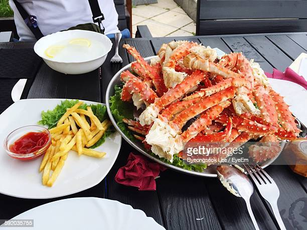 High Angle View Of French Fries And Crab Legs On Plate